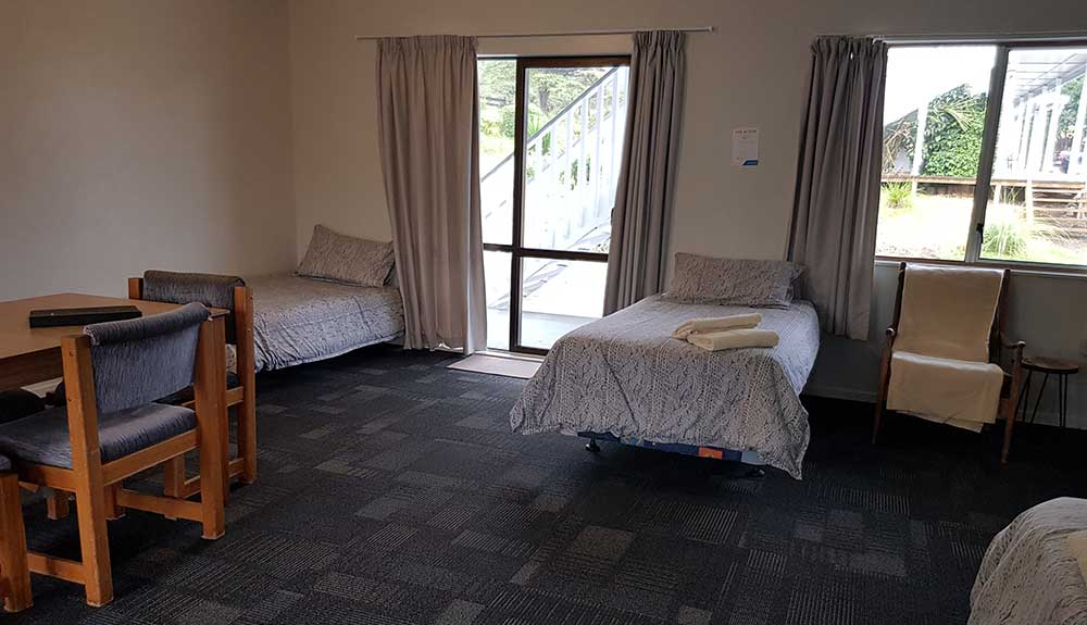 Motel unit 10 open plan beds and dining area