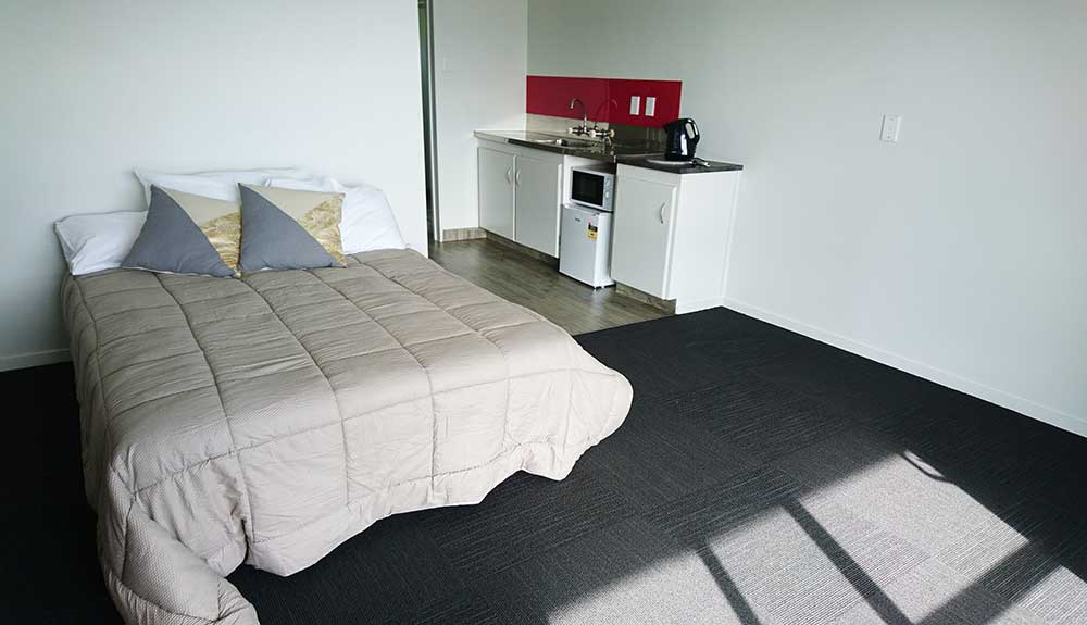 Downstairs Travellers Motel Unit Bedroom